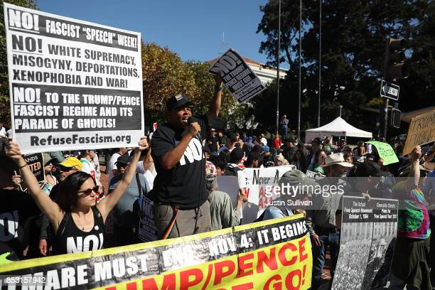 Protesters hold signs during a free speech rally with right wing commentator Milo Yiannopoulos at UC Berkeley on September 24 2017 in Berkeley...
