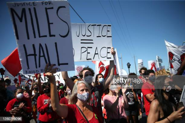 Protesters hold signs during a Juneteenth rally and march at the Port of Oakland on June 19 2020 in Oakland California Thousands of union...