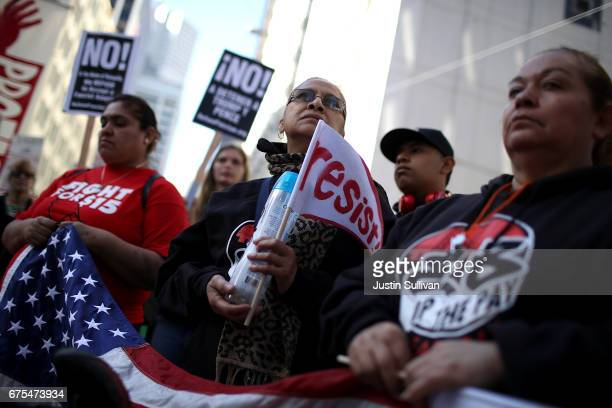 Protesters hold signs during a May Day demonstration outside of a US Immigration and Customs Enforcement office on May 1 2017 in San Francisco...