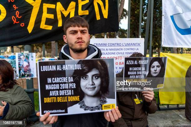 Protesters hold signs during a protest planned by organisations including the Order of Journalists and Amnesty International Italy against the...