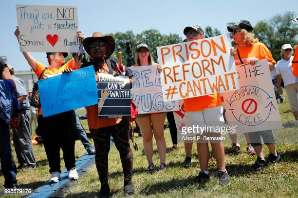 Protesters hold signs during a rally calling for criminal justice reform outside the US Capitol July 10 2018 in Washington DC Demonstrators and...