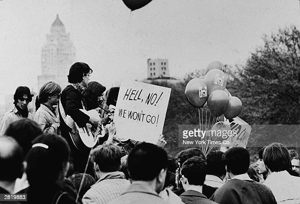 Protesters hold signs guitars and balloons during a large demonstration against the US involvement in the Vietnam War Central Park New York City 1968