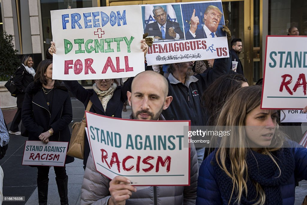 Protesters hold signs outside the American Israeli Public Affairs Committee (AIPAC) policy conference in Washington, D.C., U.S., on Monday, March 21, 2016. The presidential race will take a detour from domestic sniping today as Hillary Clinton, Donald Trump and Trump's two Republican opponents converge on Washington to address a key pro-Israel group. Photographer: Drew Angerer/Bloomberg via Getty Images