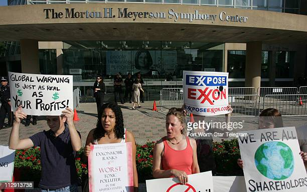Protesters hold signs outside the Meyerson Symphony Center in Dallas Texas Wednesday May 28 as Exxon Mobil Corporation holds their annual...