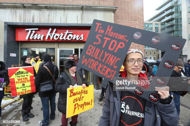 TORONTO ON JANUARY 10 Protesters hold signs outside the Tim Horton's Bloor Street West location Fight for 15 and Fairness hold a rally outside the...