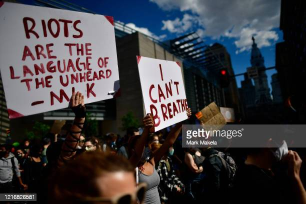 "Protesters hold signs stating ""I CAN'T BREATHE"" during a march through Center City on June 1, 2020 in Philadelphia, Pennsylvania. Demonstrations have..."