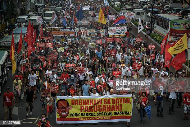 Protesters hold streamers as they march toward the presidential palace during a demonstration in Manila Philippines June 12 2014 The country's...