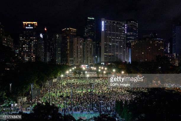 Protesters hold their candles during a moment of silence on the 31st Anniversary of the Tiananmen Massacre. Thousands gathered for the annual...