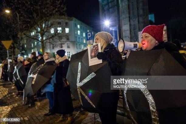 Protesters hold umbrellas bearing letters to read the expression 'Women's Rights' during an antigovernment and proabortion demonstration on January...