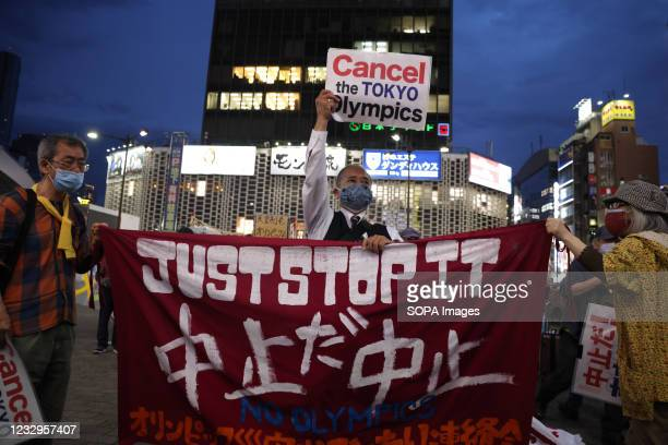 """Protesters hold up a banner that reads, """"Just Stop it. Cancel the Tokyo Olympics"""" during an anti Tokyo 2020 Olympic Games Rally in Ginza district...."""