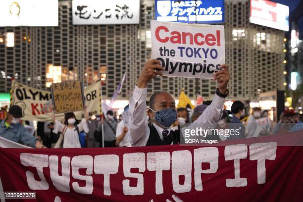 """Protesters hold up a banner that reads, """"Just Stop it"""" during an anti Tokyo 2020 Olympic Games Rally in Ginza district. Around 30 to 40 protesters..."""