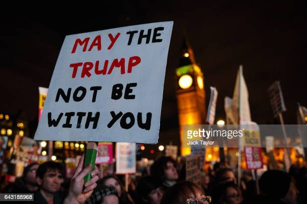 Protesters hold up a placard during a rally in Parliament Square against US president Donald Trump's state visit to the UK on February 20 2017 in...