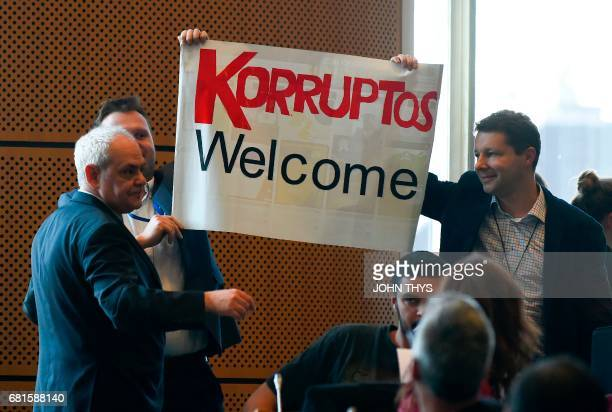 Protesters hold up a placard in reference to the corruption scandal concerning former Argentinian president Cristina Fernandez de Kirchner as...