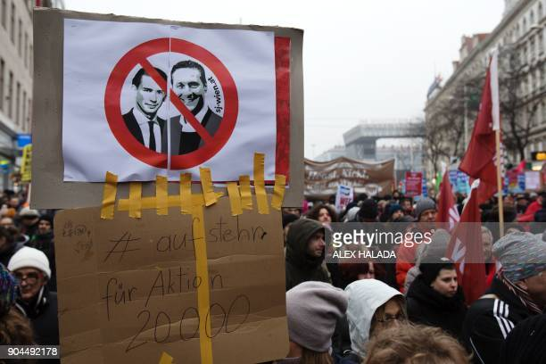 Protesters hold up a sign with the crossedout Austrian Chancellor Sebastian Kurz and Heinz Christian Strache during a demonstration against the...