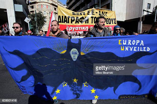 Protesters hold up banners as thousands of people take part in a demonstration on December 8 2016 in Athens Greece A nationwide 24hour general strike...