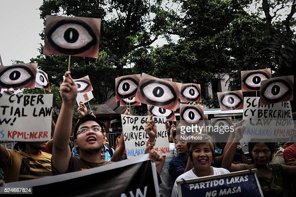Protesters hold up 'eye' placards during a demonstration to mark the global 'The Day We Fight Back' protest against mass surveillance outside the...
