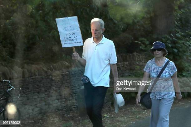 Protesters hold up placards along the route at Blenheim Palace prior the arrival of US President Donald Trump and First Lady Melania Trump on July 12...