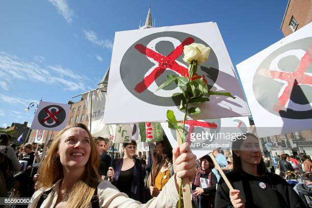 Protesters hold up placards as they take part in the March for Choice calling for the legalising of abortion in Ireland after the referendum...