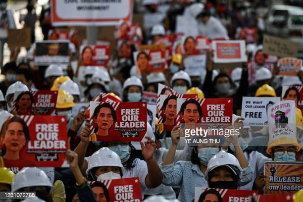 Protesters hold up placards demanding the release of detained Myanmar leader Aung San Suu Kyi during a demonstration against the February 1 military...