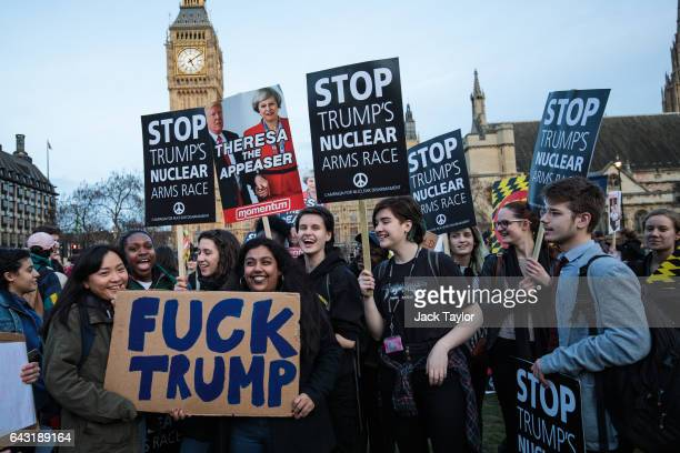 Protesters hold up placards during a rally in Parliament Square against US President Donald Trump's state visit to the UK on February 20 2017 in...