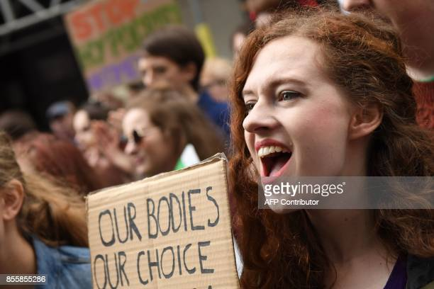 Protesters hold up placards during the London March for Choice calling for the legalising of abortion in Ireland after the referendum announcement...