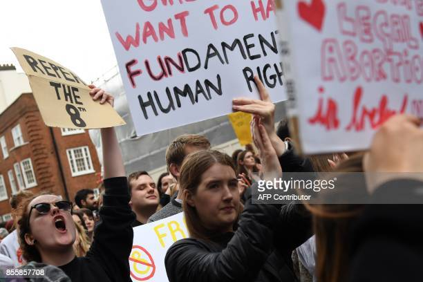 Protesters hold up placards during the London March for Choice, calling for the legalising of abortion in Ireland after the referendum announcement,...