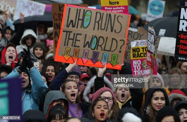 Protesters hold up placards during the Women's March in London on January 21 2018 as part of a global day of protests a year to the day since Donald...
