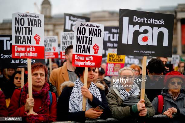 Protesters hold up placards in Trafalgar Square during a demonstration against the threat of war on Iran, in central London on January 11 - Iran said...