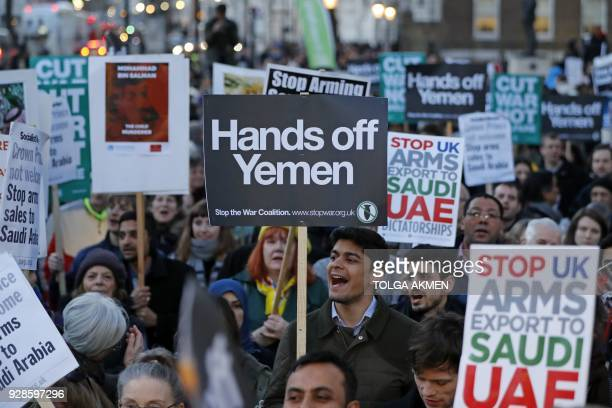 Protesters hold up proYemeni placards as they demonstrate against UK arms sales to Saudi Arabia during the visit of Saudi Arabia's Crown Prince...