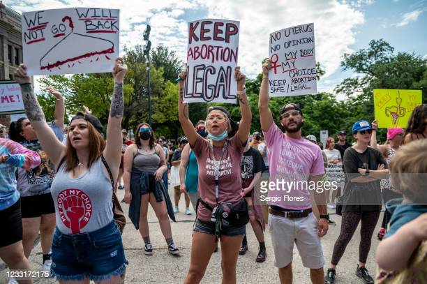 Protesters hold up signs and cheer at a protest outside the Texas state capitol on May 29, 2021 in Austin, Texas. Thousands of protesters came out in...