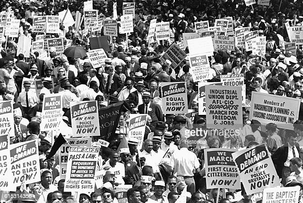 Protesters hold up signs demanding equal rights for blacks at the 1963 March on Washington DC August 28 1963