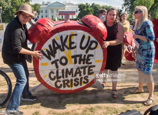 Protesters hold up signs during a demonstration in front of the White House in Washington DC on June 1 objecting to US President Donald Trump's...