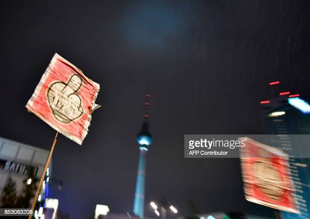 Protesters hold up signs during a protest outside an election night event of the Alternative for Germany party in Berlin after the general election...