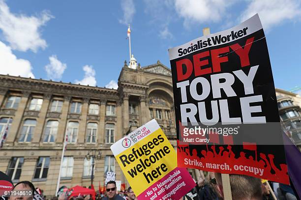 Protesters hold up signs during a TUC demonstration against austerity on the first day of the Conservative Party Conference 2016 on October 2 2016 in...