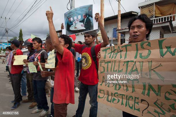 Protesters hold up signs during AntiAustralia protests on December 6 2013 in Dili East Timor The protests were organized as a strong response to...