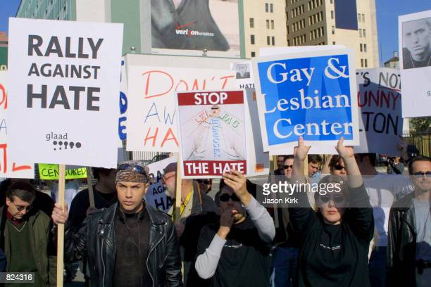 """Protesters hold up signs during """"The Rally Against Hate"""" February 21, 2001 outside the Grammy Awards at the Staples Center in Los Angeles, CA as part..."""