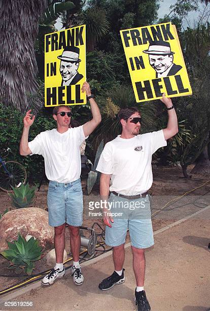 Protesters hold up signs saying 'Frank in Hell'