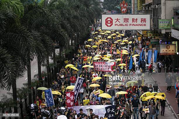 Protesters hold yellow umbrellas and banners as they march during a prodemocracy rally in Hong Kong China on Sunday Feb 1 2015 This is the first...