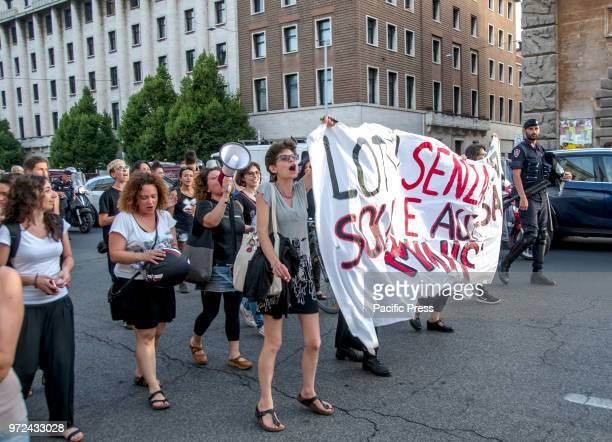 Protesters holding a banner during a demonstration under the Minister of Transport in Rome for the opening of Italian ports in the Emergency for the...