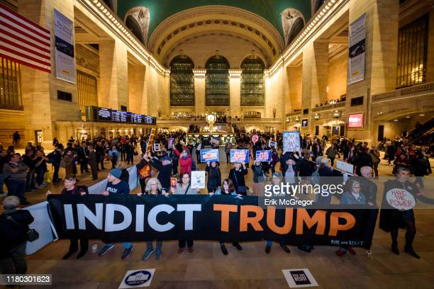 Protesters holding a banner reading INDICT TRUMP On the heels of the corrected testimony of US Ambassador to the EU Gordon Sondland admitting he...