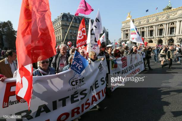 Protesters holding a banner reading « pensionners are not wealthy people» march near the Opera House during a demonstration called by pensioners'...