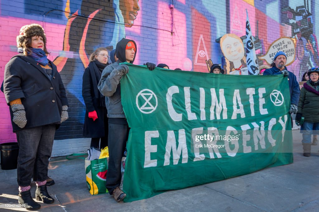 Protesters holding a Climate Emergency banner. Community... : News Photo