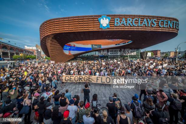 Protesters holding a giant banner reading GEORGE FLOYD outside the Barclays Center Hundreds of protesters made their way toward Barclays Center in...