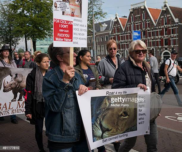 Protesters holding a placard against Cecil's killer Walter Palmer march during the 2nd official Global March for Elephants Rhinos and Lions on...