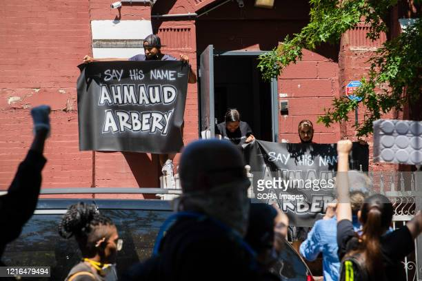 Protesters holding Ahmaud Arbery banners who was also killed recently but by two white civilians during a demonstration Several protests around US...