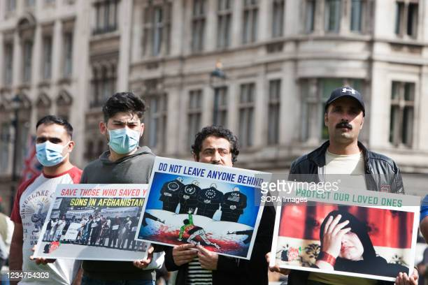 Protesters holding anti-Taliban placards, during the demonstration. Protesters including former interpreters for the British Army gathered in...