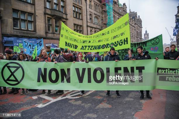 Protesters holding banners during the demonstration Extinction Rebellion held a lockdown of Edinburgh's North Bridge as part of an international...