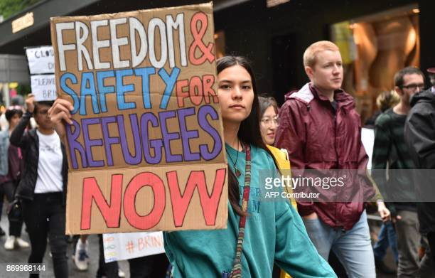 Protesters holding banners march in Sydney to urge the Australian government to end the refugee crisis on Manus Island on November 4 2017 The United...