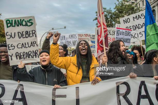 Protesters holding placards and banner during the protest Hundreds of people of different ethnicity background protested against racism outside the...