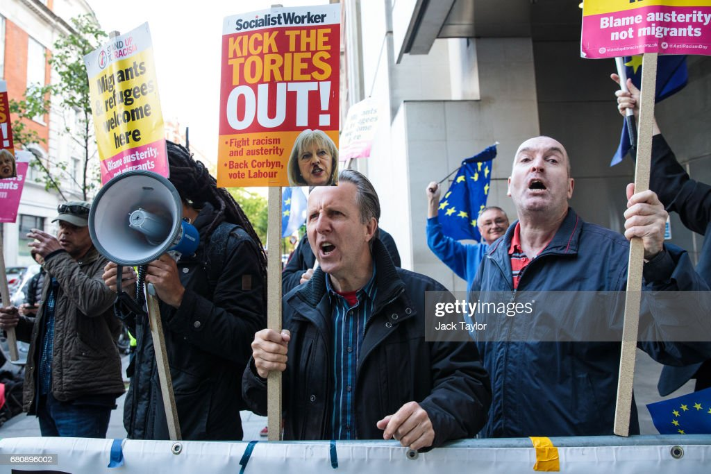 Protesters holding placards chant as they demonstrate outside BBC's Broadcasting House as British Prime Minister Theresa May and her husband Philip May give a joint interview on the One Show on May 9, 2017 in London, England. Campaigning is underway ahead of the June 8th general election.